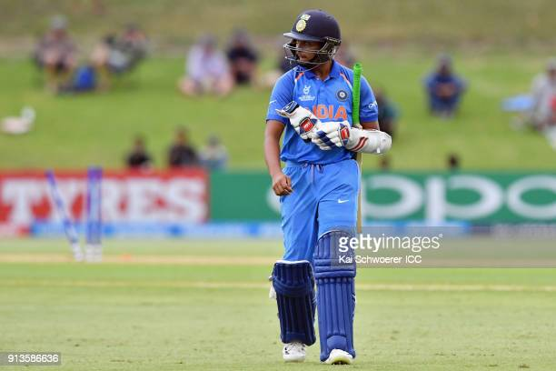 Prithvi Shaw of India looks dejected after being dismissed by Will Sutherland of Australia during the ICC U19 Cricket World Cup Final match between...