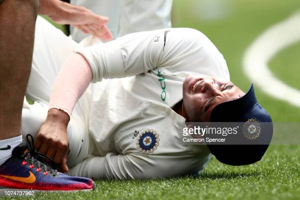 Prithvi Shaw of India receives attention after injuring his leg following an attempted catch on the boundary during day three of the International...