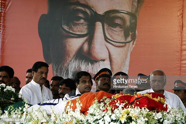 Prithviraj Chavan Nitin Gadkari and Sharad Pawar pay their last respect to Bal Thackeray at Shivaji Park on November 18 2012 in Mumbai India Bal...
