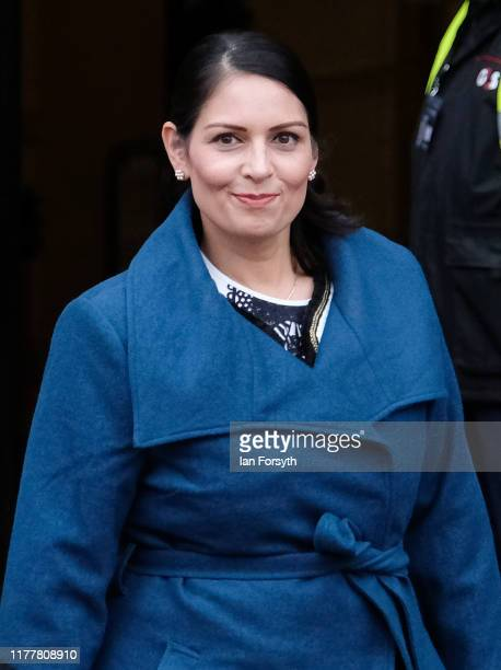Priti Patel Secretary of State for the Home Department leaves the Midland Hotel for a media appearance on the first day of the Conservative Party...
