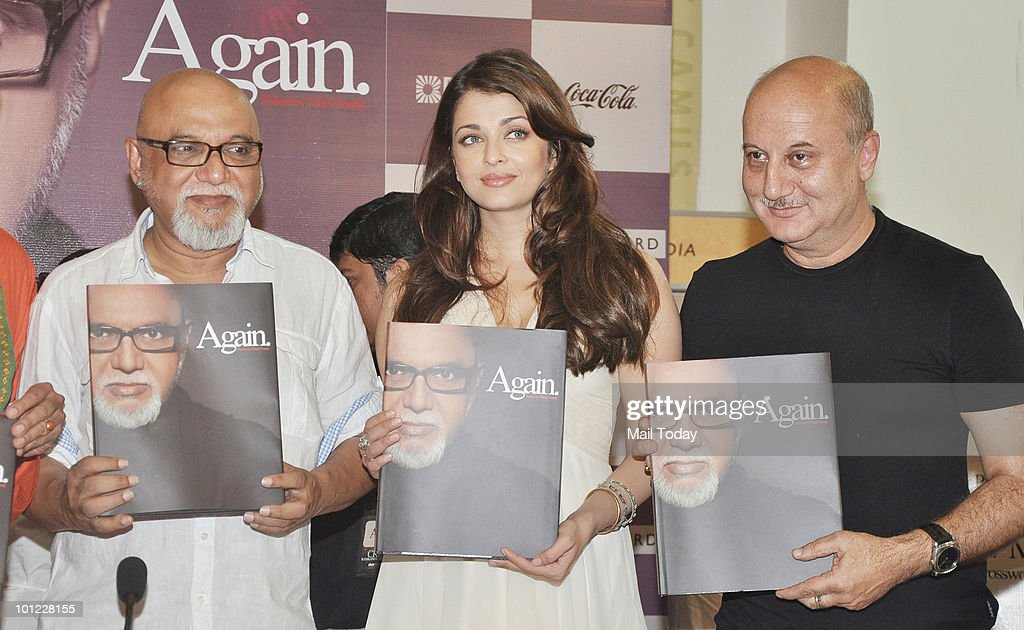 Pritish Nandy and Bollywood actors Aishwarya Rai Bachchan and Anupam Kher unveil Nandy�s book of poems 'Again' in Mumbai on May 27, 2010.