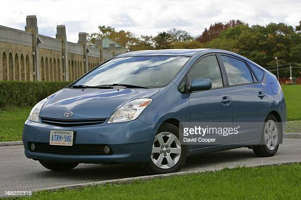 Prius with 100000 km on the Odometer Driver Cody Storm Cooper with the car at the RC Harris filtration plant in the Beaches