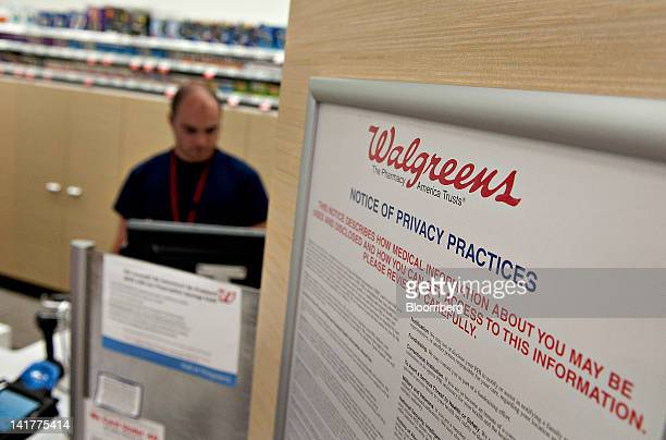 A privacy notice hangs near the pharmacy counter at a Walgreen Co store in Chicago Illinois US on Friday March 23 2012 Walgreen Co is scheduled to...