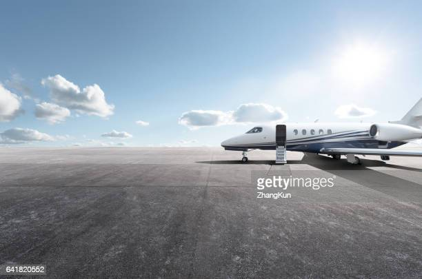 private aircraft parked on the tarmac - airfield stock pictures, royalty-free photos & images