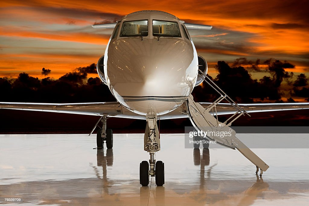 Private airplane at sunset : Stock Photo