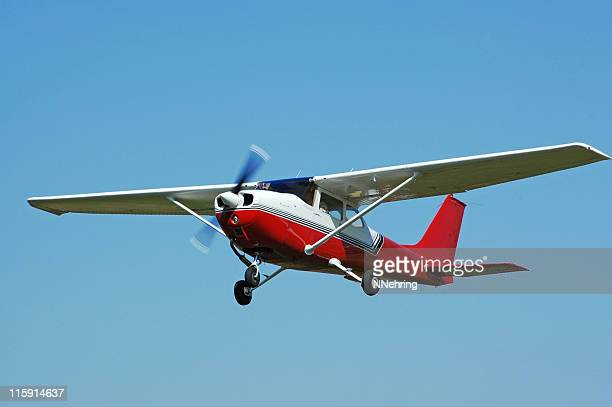 private airplane Cessna 172 flying in clear blue sky