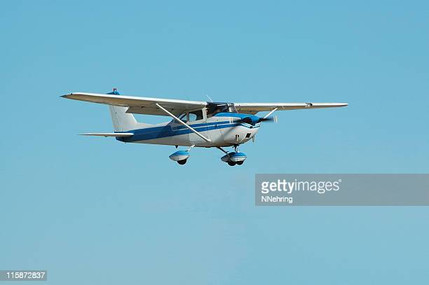private airplane Cessna 172 in clear blue sky