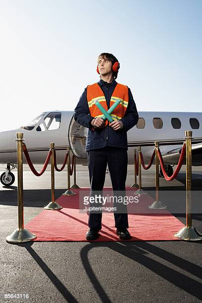 Private airplane with airport ground crew