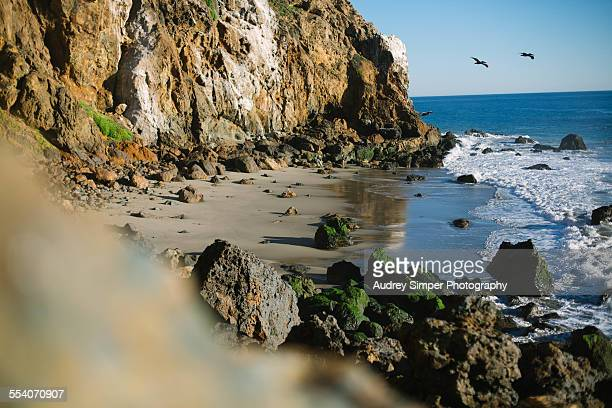 private beach on pacific coast - zuma beach stock photos and pictures
