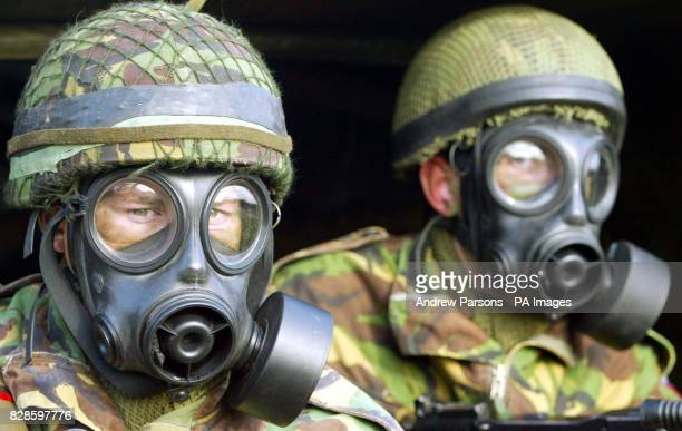 Private Charlie Curnow holding a SA80A2 with Private Neil Clish holding a GPM from 3rd Battalion practice wearing gas masks at a press day near their...