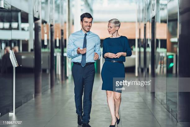 private conversation outside the office - adults only stock pictures, royalty-free photos & images