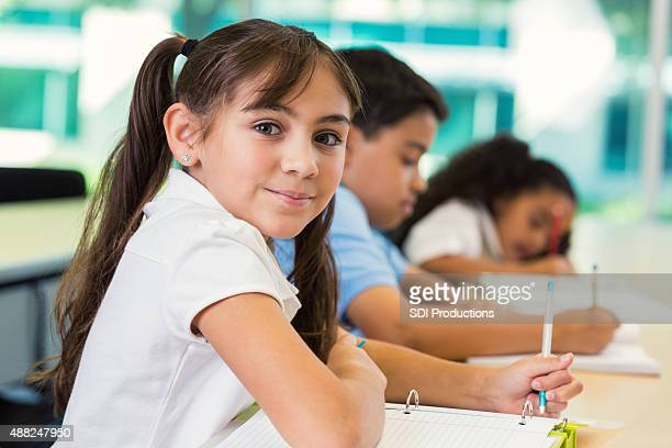 Private elementary school students taking test in classroom