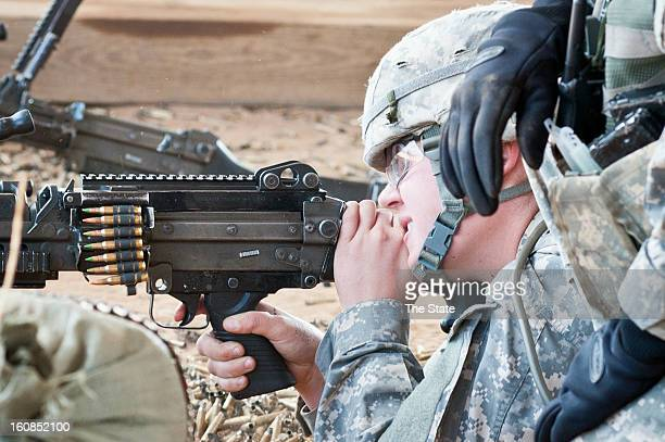 Private first class Christine Nelms fires a 249 SAW machine gun during training at Fort Jackson in Columbia South Carolina January 30 2013