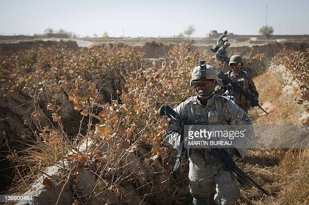 Private First Class Richard Thompkins from Atlanta of the 502nd Infantry regiment 2nd Batallion Charger company 1st platoon patrols around Ahmed Khan...