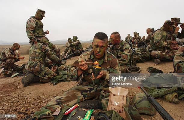 Private First Class William Draughon of G Company 2ed Battalion Fourth Marine Division takes a break to eat during combat readiness training October...