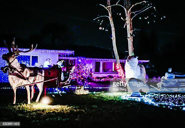 Woodland Hills Ca December 19 2014 A private home is transformed into a christmas lights display featuring a reindeer pulling Santa Claus's sled and...