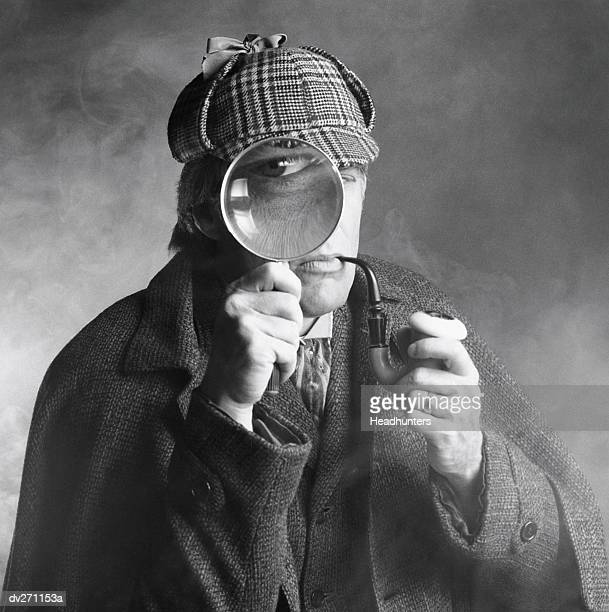 private investigator looking through magnifying glass - sherlock holmes stock pictures, royalty-free photos & images