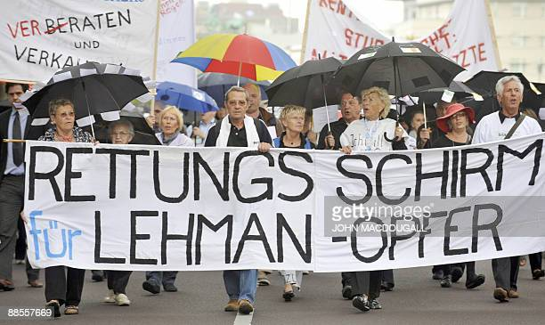 Private investors who lost money following the collapse of US financial giant Lehman Brothers display banners during a protest in Berlin June 18 2009...