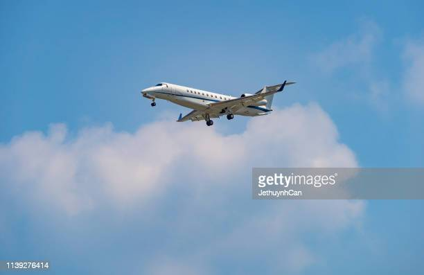 private jet fly in the cloud blue sky - 自家用飛行機 ストックフォトと画像
