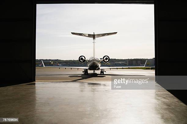 Private Jet Parked Near Hangar