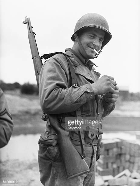 Private John Ziaja of Adams Massachusetts wearing the new steel M1 helmet at his quarters in Great Britain during World War II June 1942
