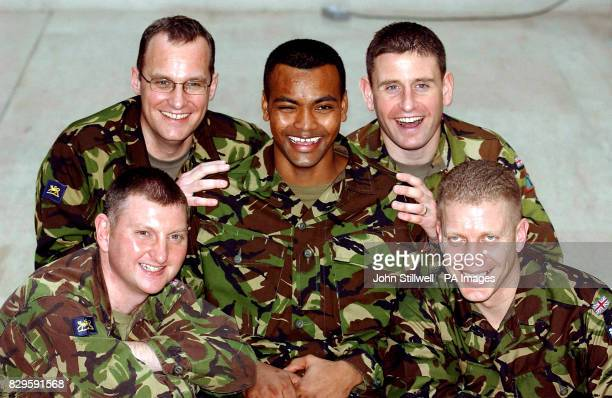 Private Johnson Gideon Beharry from 1st Battalion the Princess of Wales's Royal Regiment with his colleagues Lt Col Matt Maer who received the...
