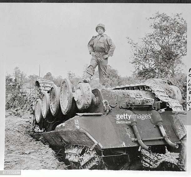Private Joseph Silva has a good right to act chesty as he stands in this victorious pose atop a kayoed German Tiger tank in Normandy Silva's division...