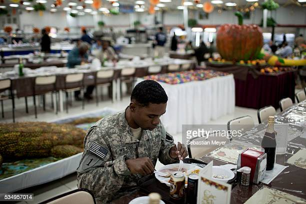 Private Kadmiel Wilson from Pontiac MI eats Thanksgiving lunch at Sather Airforce Base November 24 2011 is the last Thanksgiving US troops will be...