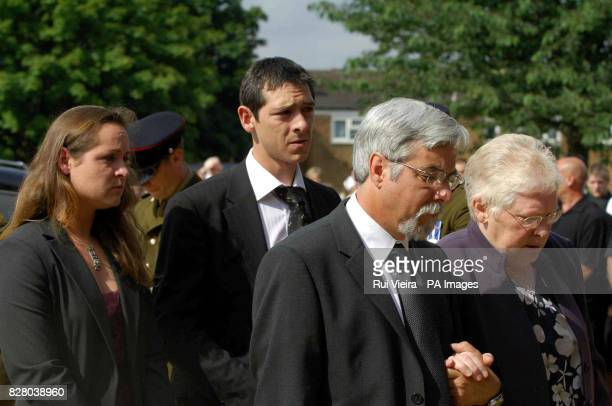 Private Leon Spicer's parents Christopher and Bridiem followed by brother Gerard and sister Nina arrive at The Sacred Heart Roman Catholic Church in...