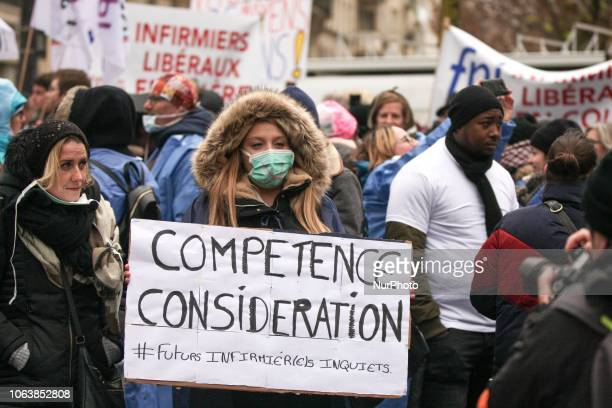 Private nurse hold placard reading « expertise consideration » during a demonstration in front of headquarters of the Ministry of Health in Paris on...
