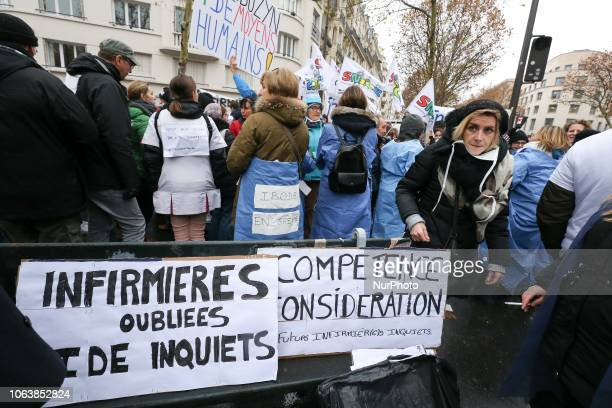 Private nurse hold placards reading « expertise consideration » and « nurses forgotten and worried » during a demonstration in front of headquarters...