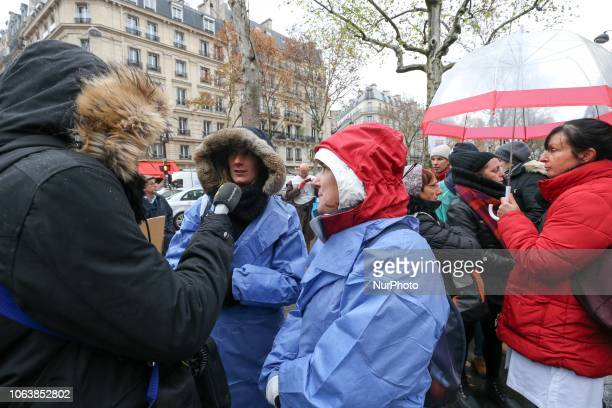 Private nurse speaks with press during a demonstration in front of headquarters of the Ministry of Health in Paris on November 20 to protest their...