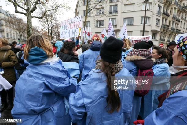 Private nurses take part in a demonstration in front of headquarters of the Ministry of Health in Paris on November 20 to protest their status in the...