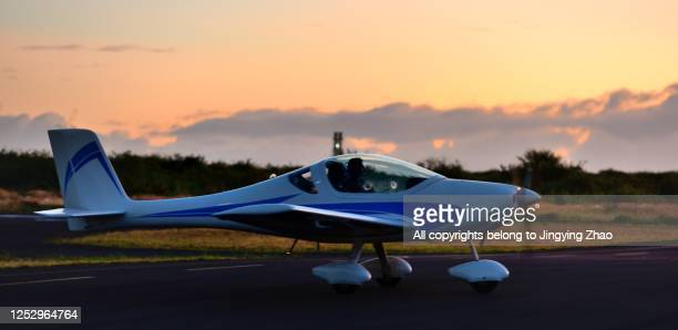 a private plane ready to take off in the morning glow - canadian snowbird stock pictures, royalty-free photos & images