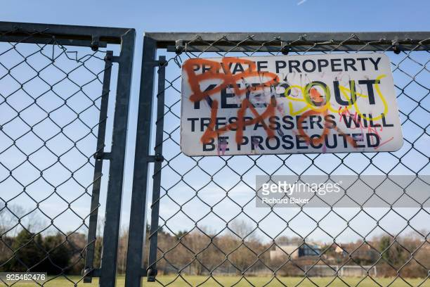 A 'Private Property Keep Out Trespassers Will Be Prosecuted' sign on a chain fence in the borough of Southwark on 24th February 2018 in south London...