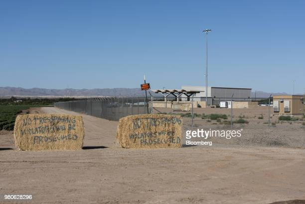 Private property signs block entrance to a dirt road along the perimeter of a tent encampment recently built near theTornilloPortofEntry in...