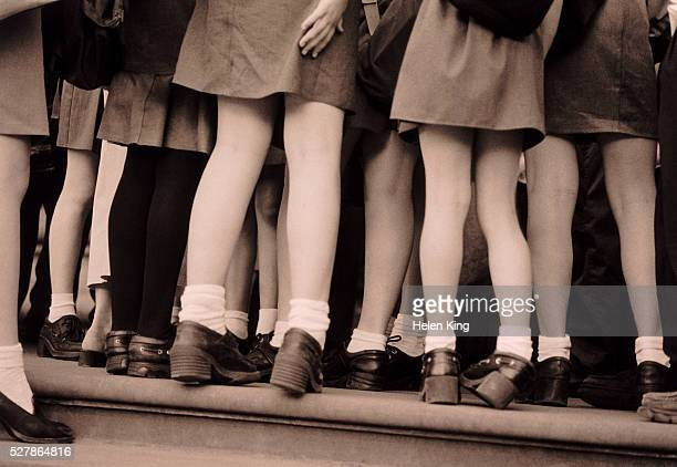 private schoolgirls - short skirt teens stock photos and pictures