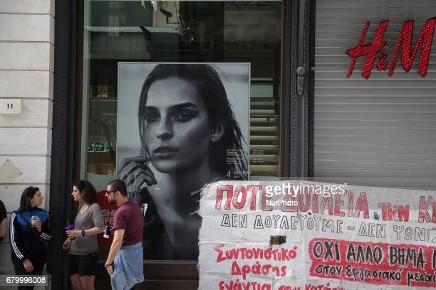 Private sector employees protest outside of an HampM store with banner against work on Sundays in central Athens Greece on Sunday May 7 2017 In the...