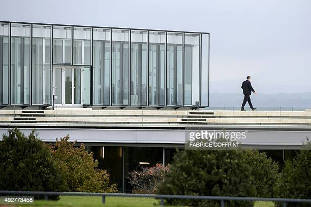 A private security agent walks on the roof of European football's governing body headquarters in Nyon on October 15 prior to a meeting of the UEFA...
