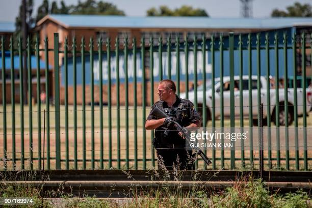 A private security guard stands outside the Hoerskool Overvaal school during a protest against admission and language policies on January 19 2017 in...