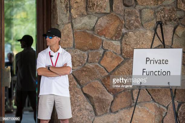 A private security officer stands at the entrance to the Sun Valley Resort as guests begin to arrive for the annual Allen Company Sun Valley...