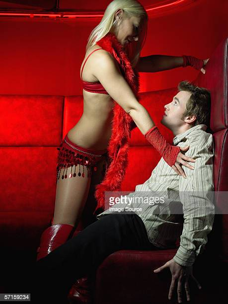 private strip tease - women dominating men stock photos and pictures