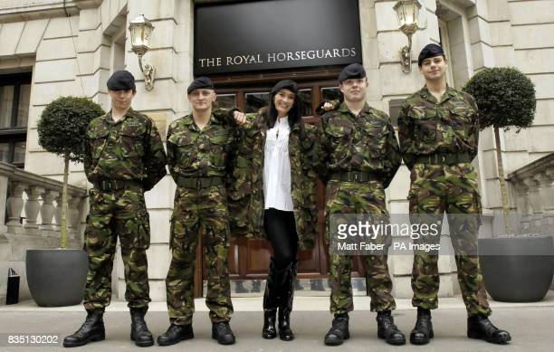 Privates Bartlett Sinclair Carrigan and Almond of The Household Cavalry pose with model and Help for Heroes ambassador Peta Todd during the relaunch...