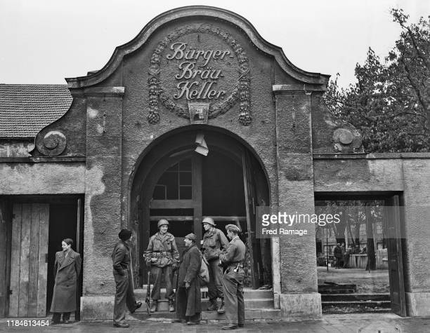 Privates Samuel Banz and Edward de Young of the United States Army and Chicago USA talk with two recently released prisoners of war outside the...