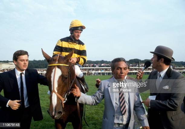 Prix de l'Arc de Triomphe winner Trempolino ridden by Pat Eddery is led in after the race at Longchamp on 4th October 1987