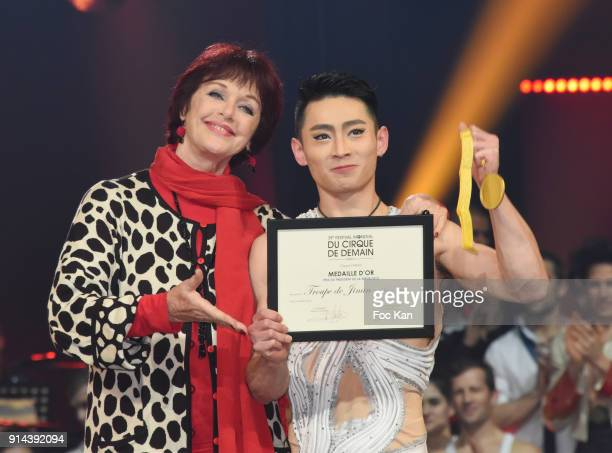 Prix du President de la Republique golden medal Prix Telmondis awarded acrobat/equilibrist Haitao Kong from Jinan Company receives his prize from...