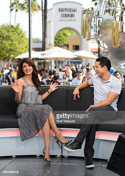 Priyanka Chopra and Mario Lopez visit Extra at Universal Studios Hollywood on September 28 2015 in Universal City California