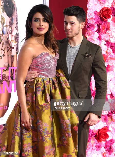 "Priyanka Chopra and Nick Jonas arrive at the Premiere Of Warner Bros. Pictures' ""Isn't It Romantic"" at The Theatre at Ace Hotel on February 11, 2019..."
