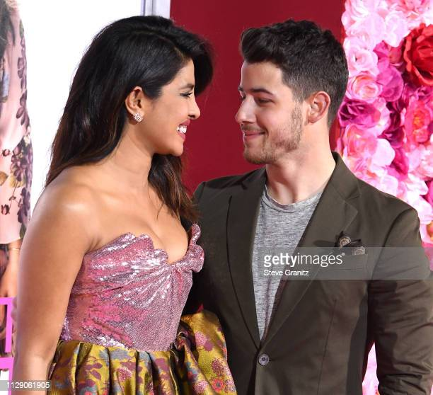 Priyanka Chopra and Nick Jonas arrive at the Premiere Of Warner Bros Pictures' Isn't It Romantic at The Theatre at Ace Hotel on February 11 2019 in...