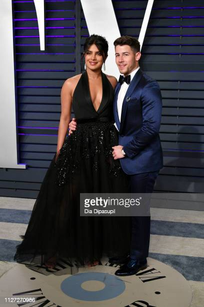 Priyanka Chopra and Nick Jonas attend the 2019 Vanity Fair Oscar Party hosted by Radhika Jones at Wallis Annenberg Center for the Performing Arts on...